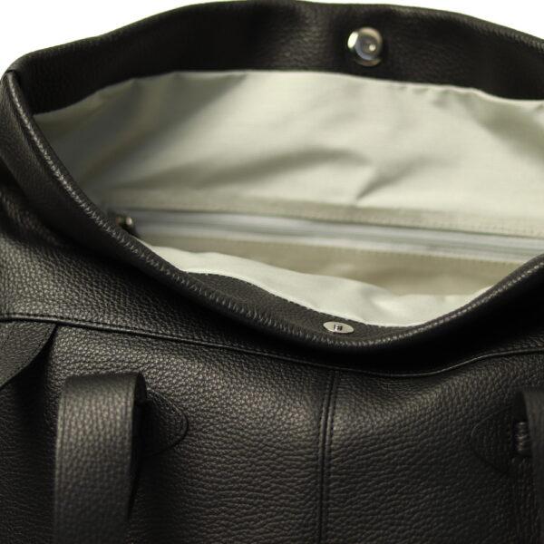 Vnitrek kozene kabelky cerna